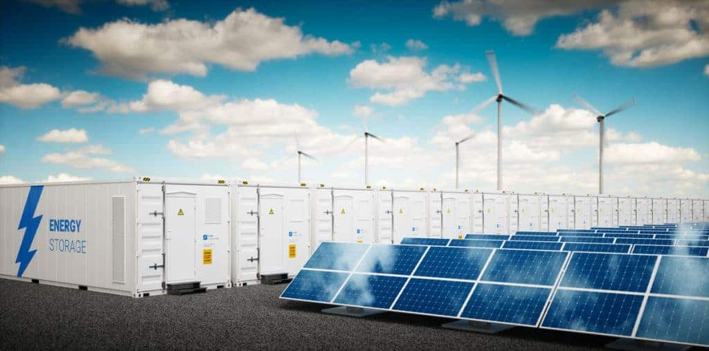 solar panels next to band of batteries for energy storage