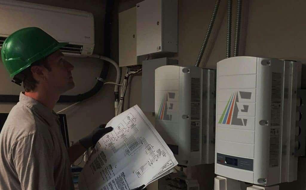 worker performing ashrae energy audit