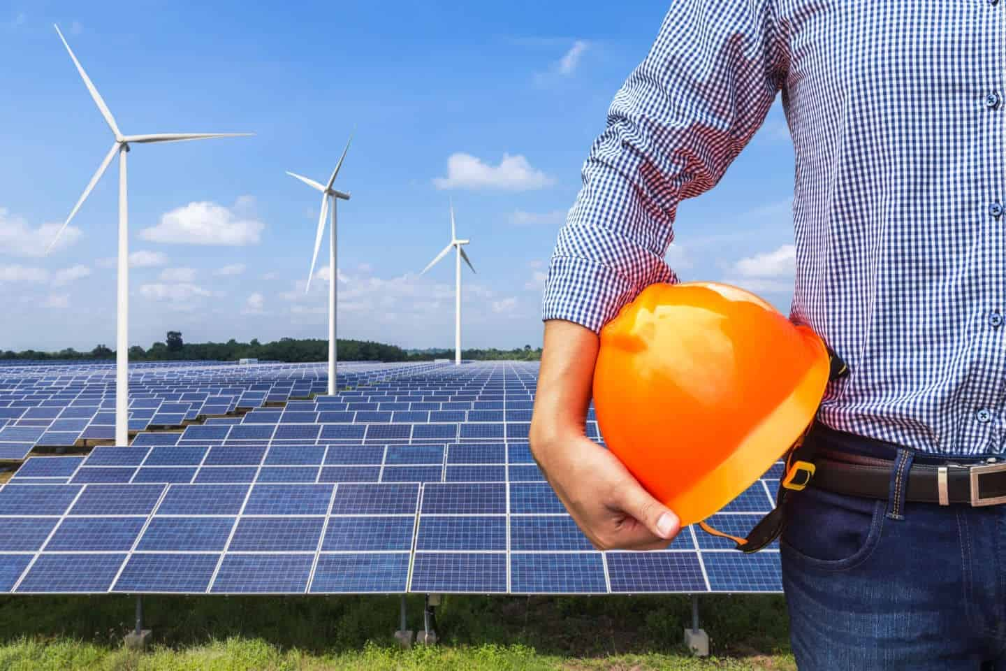 engineer stand holding yellow construction helmet front solar photovoltaic and wind turbines generating electricity power station