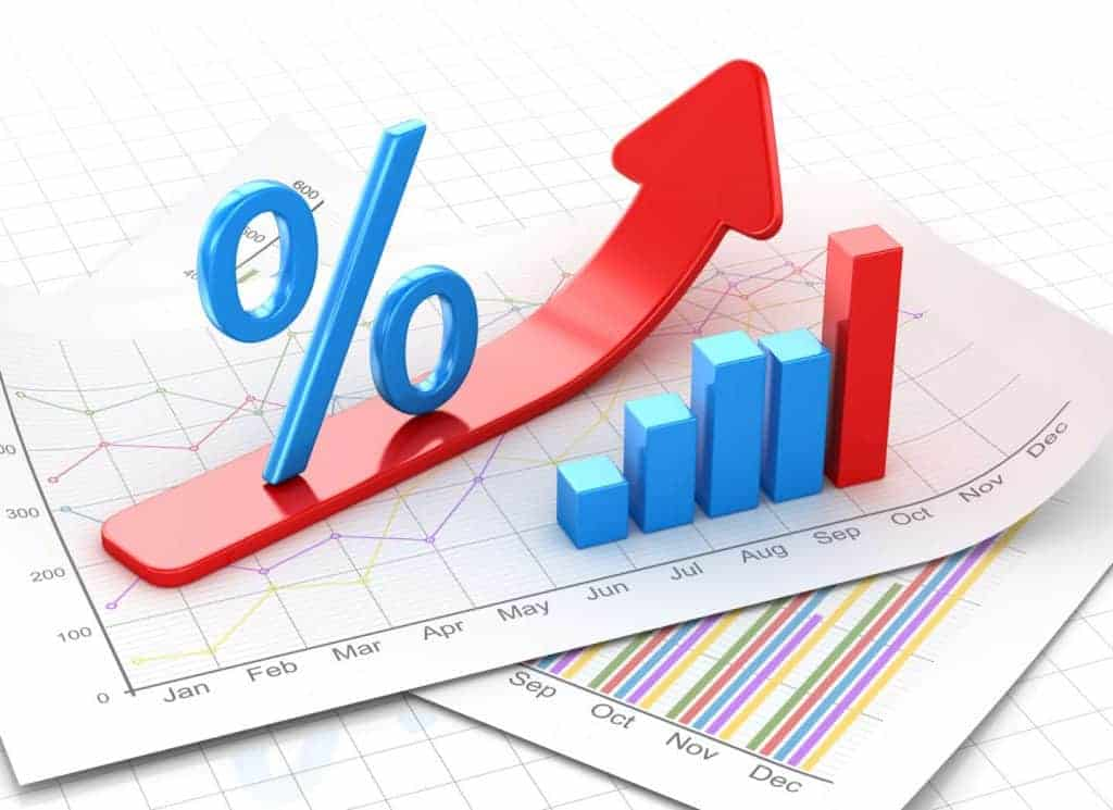 Percent symbol and business chart on financial paper
