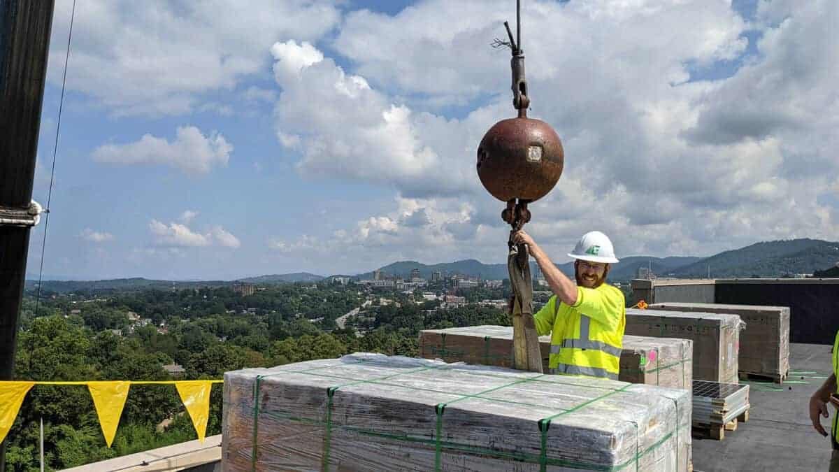 EnergyLink crew unloading materials at the Buncombe County Allied Health job site
